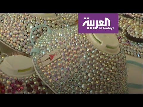 شاهد: أردنية تصنع كمامة على الموضة مزينة بالأحجار اللامعة