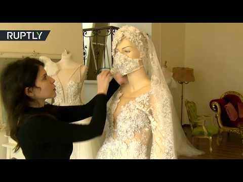 شاهد خياطة كمامات تُناسب فساتين الزفاف وتقي العروس من عدوى كورونا