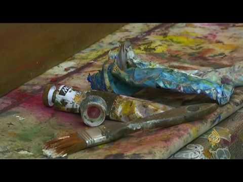 شاهد: فنانة سورية لاجئة تداوي جراح الحرب بلوحات